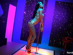 Romi Rain gets wild on the stripper pole