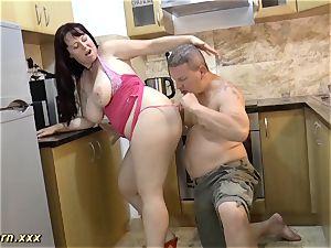 plumper stepmom gives footjob