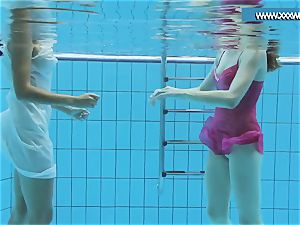 Hotly dressed teenagers in the pool