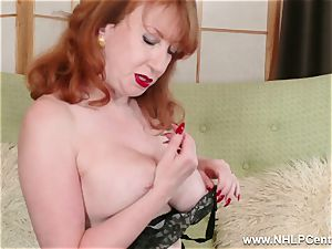 big-chested red finger ravages fuckbox in garter nylons and pumps