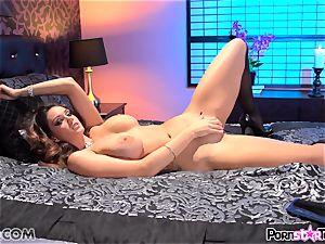 Alison Tyler showing off her goods