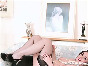 dark-haired in lingerie opens up nylon gams thumbs pussy