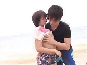 Saya Tachibana hump at the beach with a wild guy