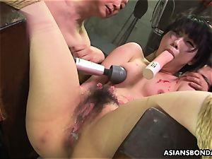 asian biotch enjoys to be bdsm handled to a wax flash