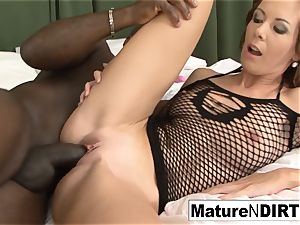 dark haired cougar strokes before taking a big black cock