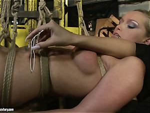 Kathia Nobili and Mandy Bright figure tying with strap