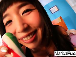 Marica plays with candy pecker